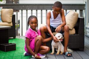 kids with dog feeding treat