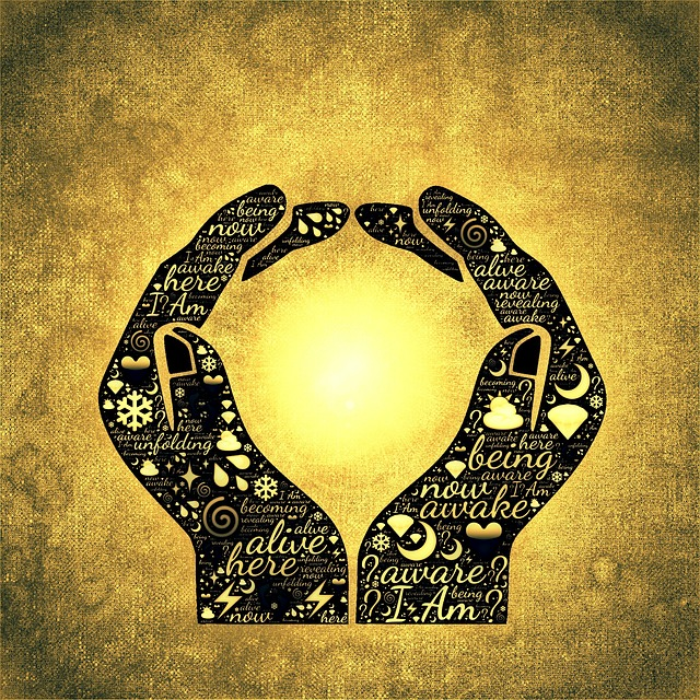A digital art image of two hands holding the sun, and inside the dark image of the hands are inspirational words like be here now awake alive aware unfolding being, used as the navigation button for the Belief, Meaning & Purpose page of The Ultimate Healing Guide on The Body Is Mind Website. Click on this button to navigate to that page.