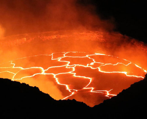 this image of a lava cauldron or volcano lava pool is used as the header image for the heat therapy article of the Ultimate Healing Guide - The Body Is Mind