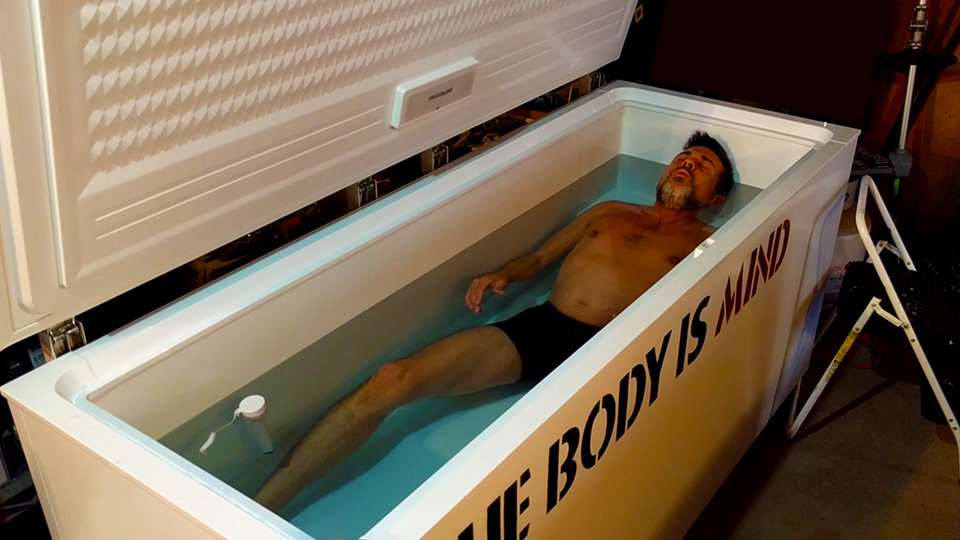 Les Konley in the DIY freezer cold tub cold therapy freezer ice bath at TheBodyIsMind