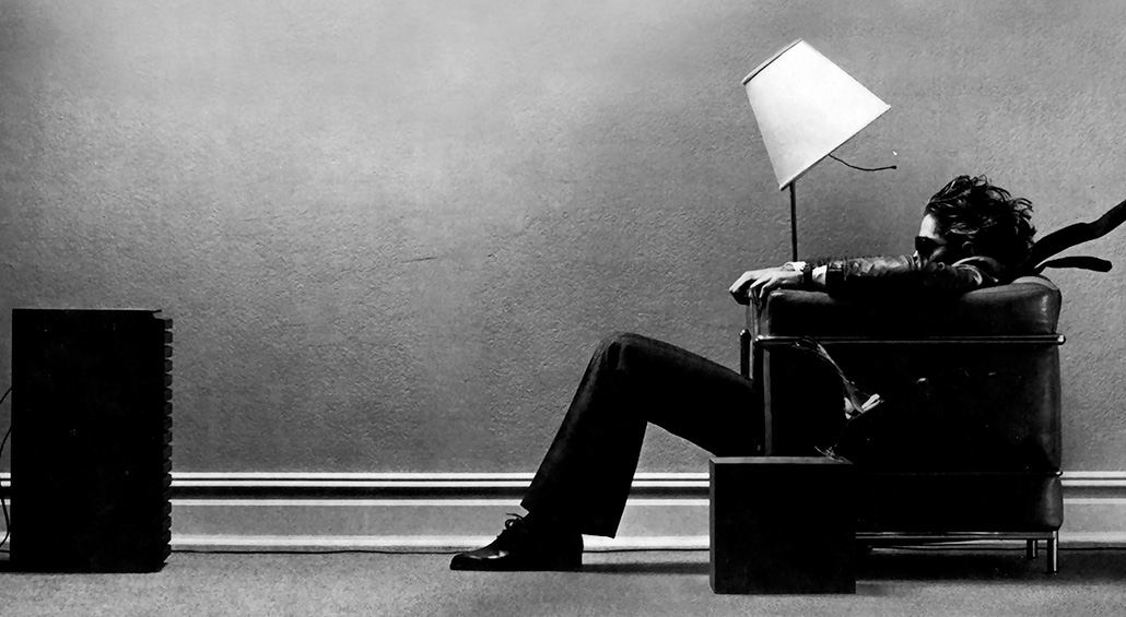 the classic maxell 500 plays blown away guy advertisement of a man sitting in front of a single speaker which appears to be blasting sound and is used as the header image for the sound therapy article on the Ultimate Healing Guide - The Body Is Mind