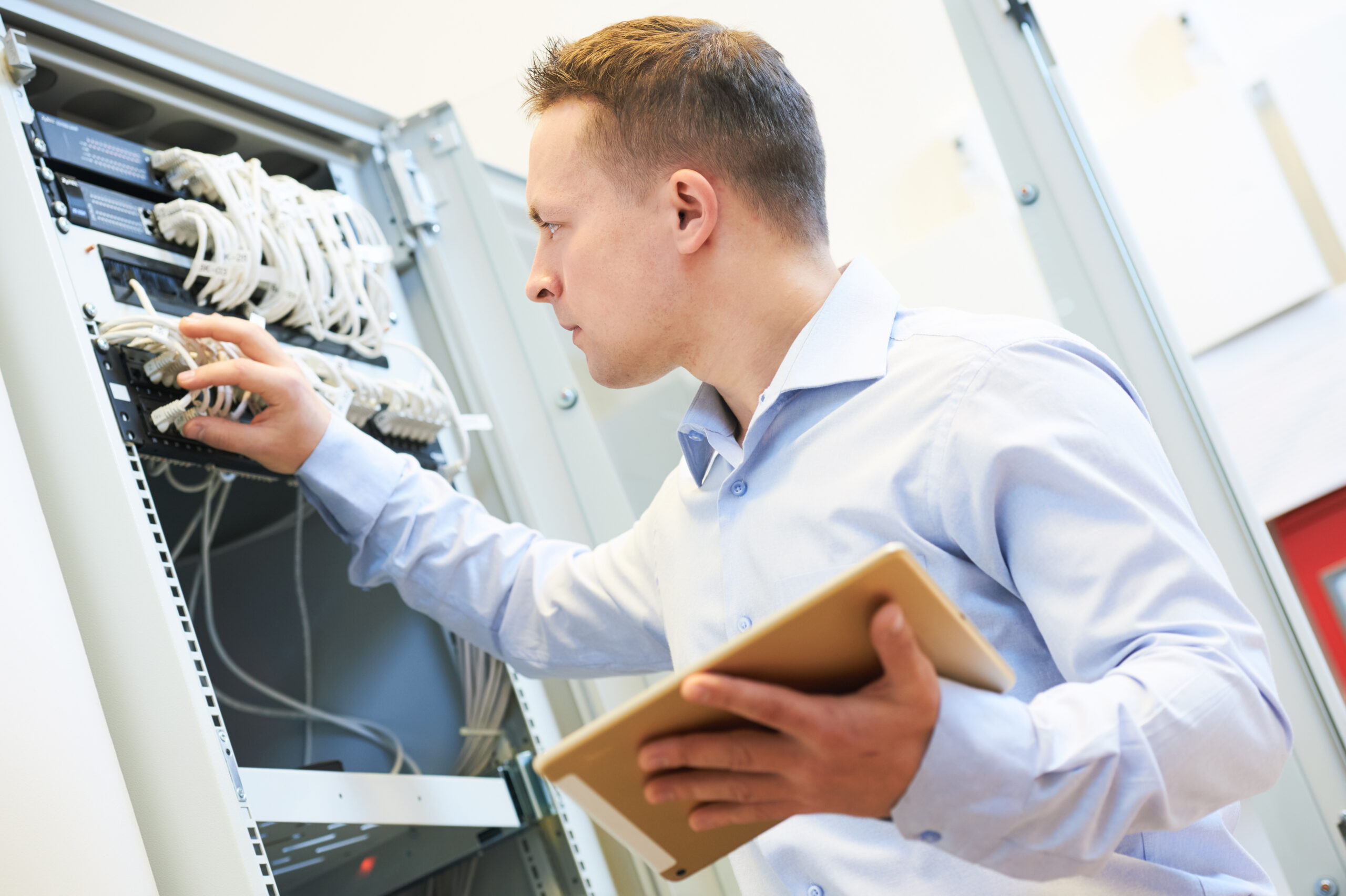 Utah IT Professional Working on Server