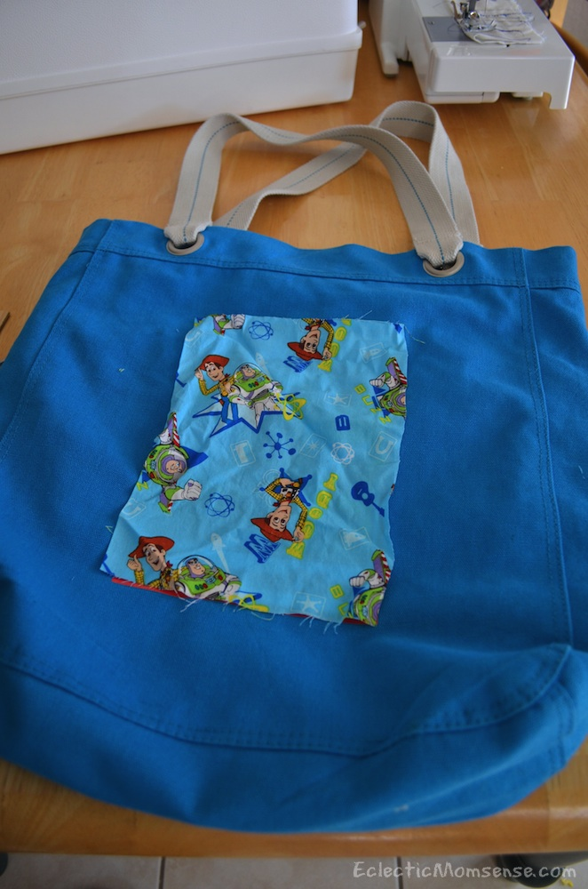 A promotional reusable tote becomes a fashionable library tote for kids. #upcycle #recycle #craft