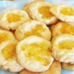Orange Marmalade Thumbprint Cookies- Delicious white chocolate chip cookie with a spoonful of Orange Marmalade.