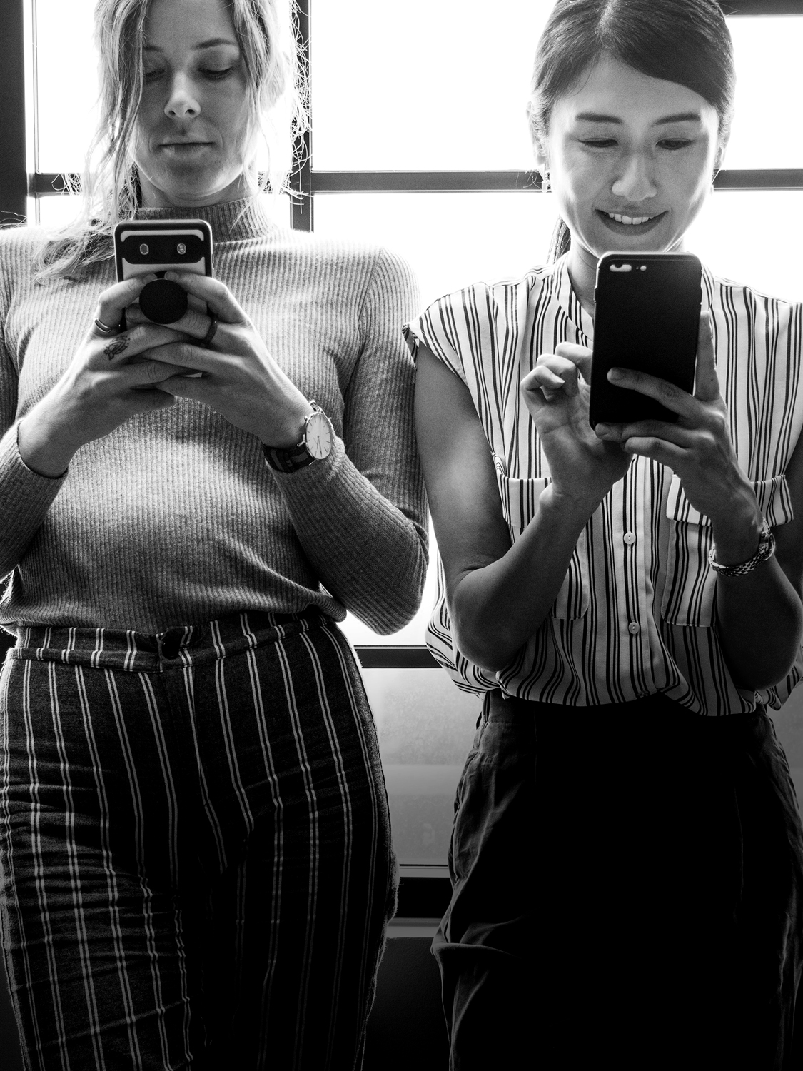 Two females on their phones