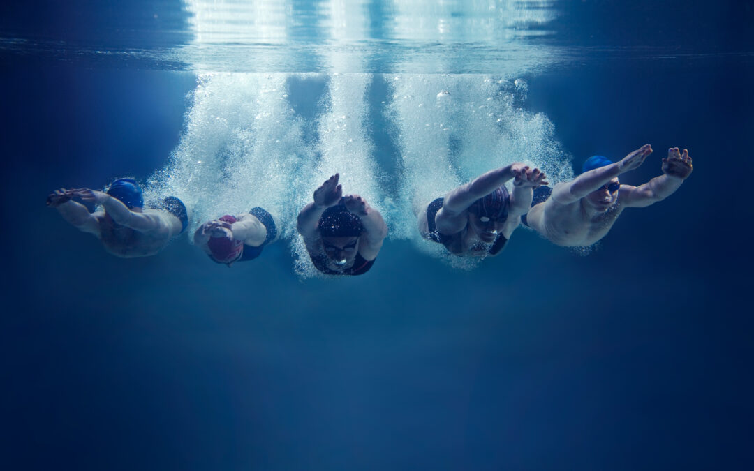 Synchronized Divers in pool