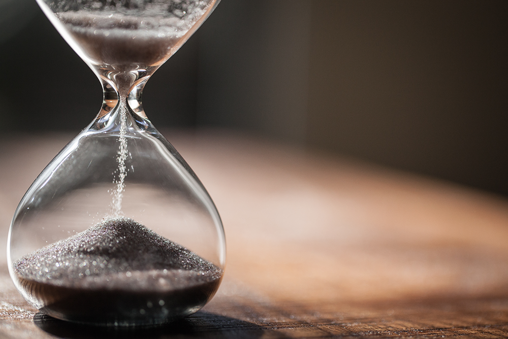 Time represented by sand in an hourglass