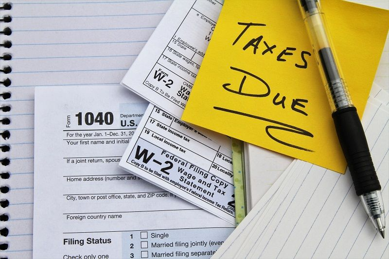 Tax-return-forms-and-wage-statements-with-note-Taxes-Due-cm