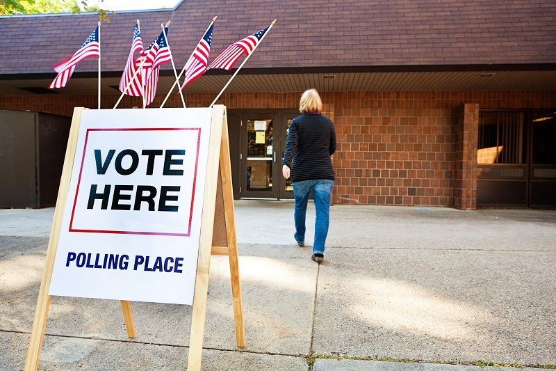 Woman-Voter-Entering-Voting-Polling-Place-for-USA-Government-Election-cm