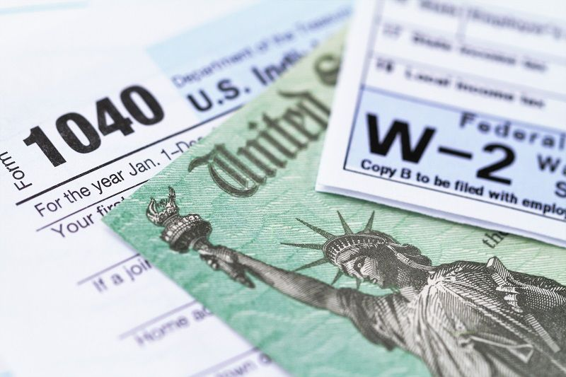 IRS-tax-forms-with-tax-refund-check-cm