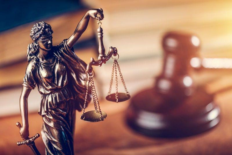 Law-concept---Themis-statue,-judge-hammer-and-books.-cm
