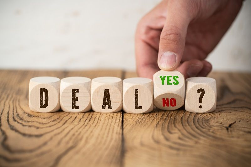 wooden-blocks-with-the-word-deal-hand-turning-cube-with-answers-yes-and-no-cm