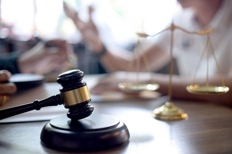 Lawyer-or-judge-gavel-with-balance-handshake-cm