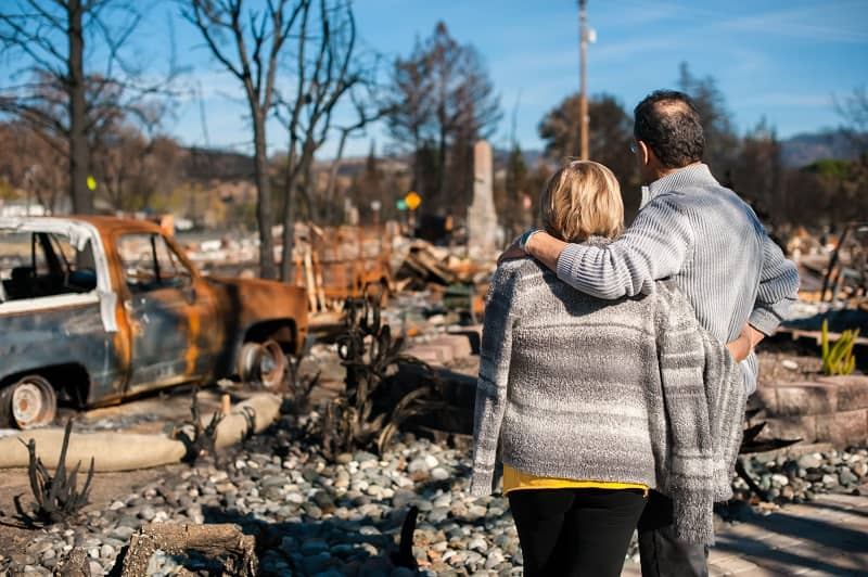 Couple checking ruins after fire disaster.-cm (1)