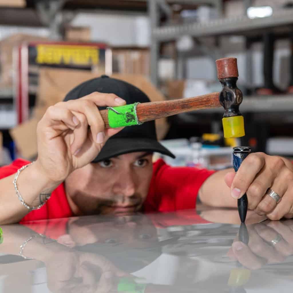 Paintless Dent Repair technician, hard at work.