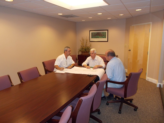 Kapura Consulting at Conference Table
