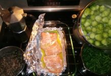 Wild caught Alaskan Salmon baked with butter, brussels sprouts and Lundberg's wild rice mix on the stove