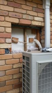 Wall ruined by an old air conditioner being removed