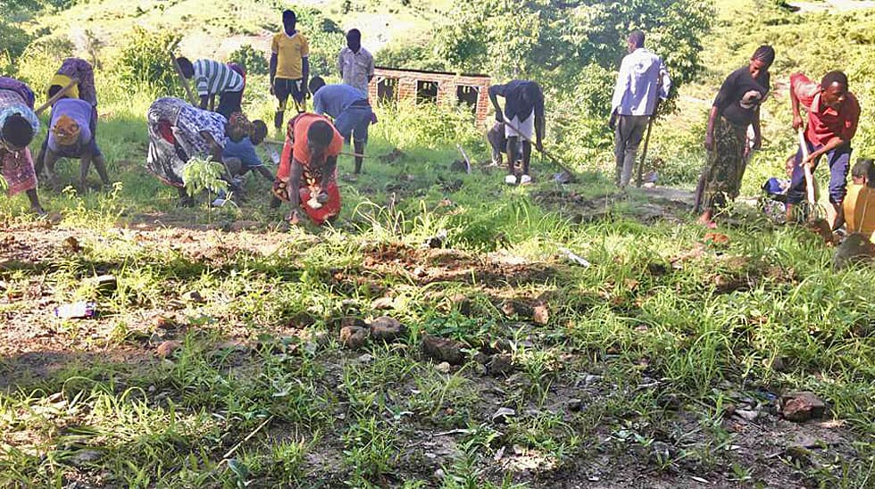 Determined to Develop Malawi Planting Trees 2
