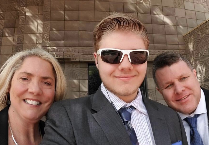 Cynthia Macluskie and her husband and son in suits