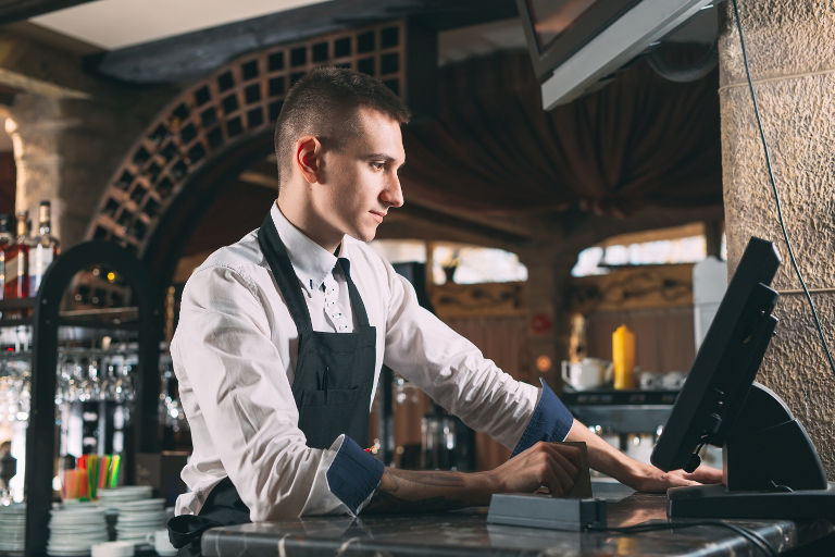 waiter using point of sale system