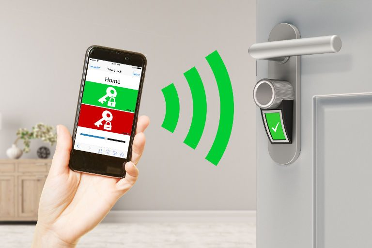 person holding a phone showing smart lock technology