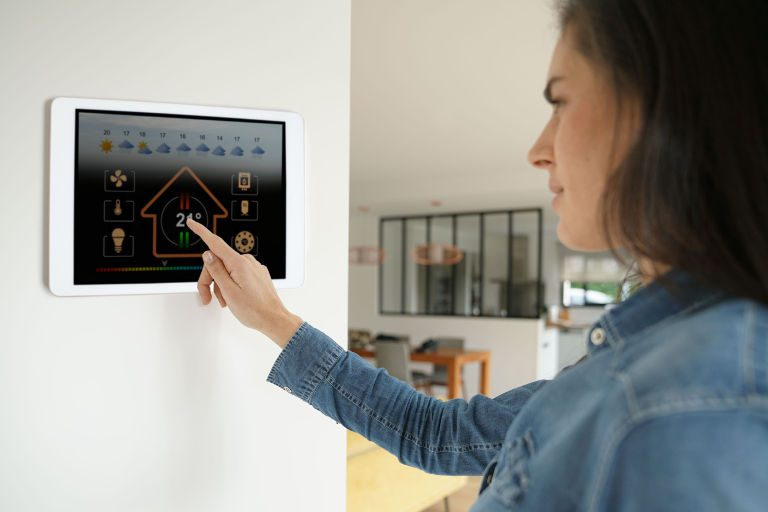 woman using a in wall smart tablet