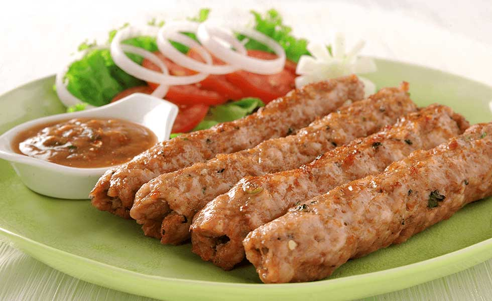 Delicious Seekh kebabs served with Salad & Chutney
