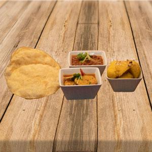 Breakfast menu consisting of halwa puri & curry