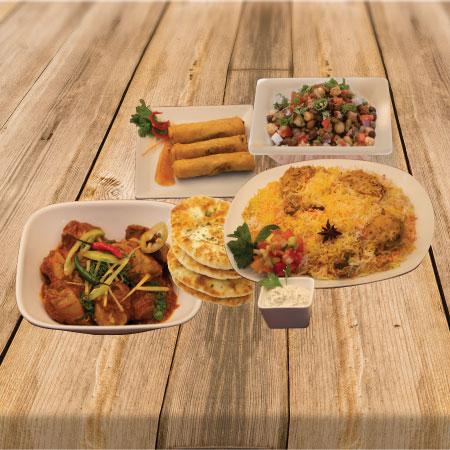 Chicken Biryani with Broast, naan & samosas & rolls.