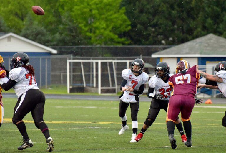 Allison Cahill of the Boston Renegades throws a football