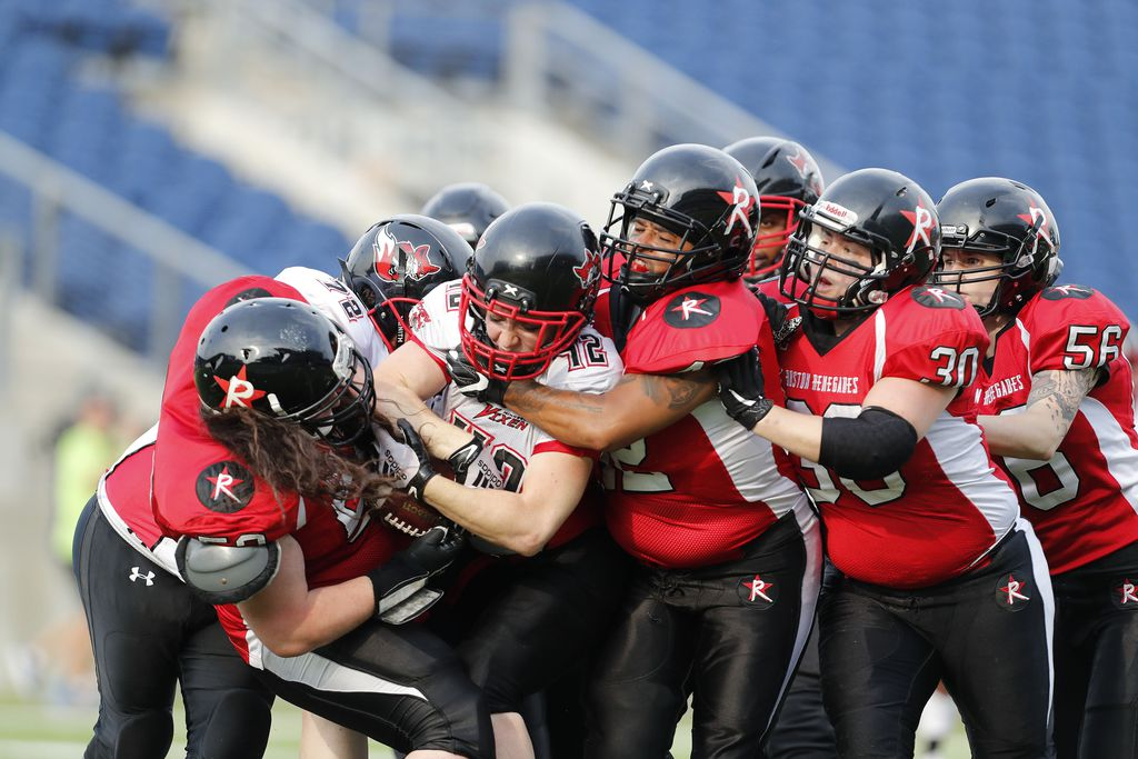 Grace Cooper of the Minnesota Vixen gets tackled by a swarm of Boston Renegades