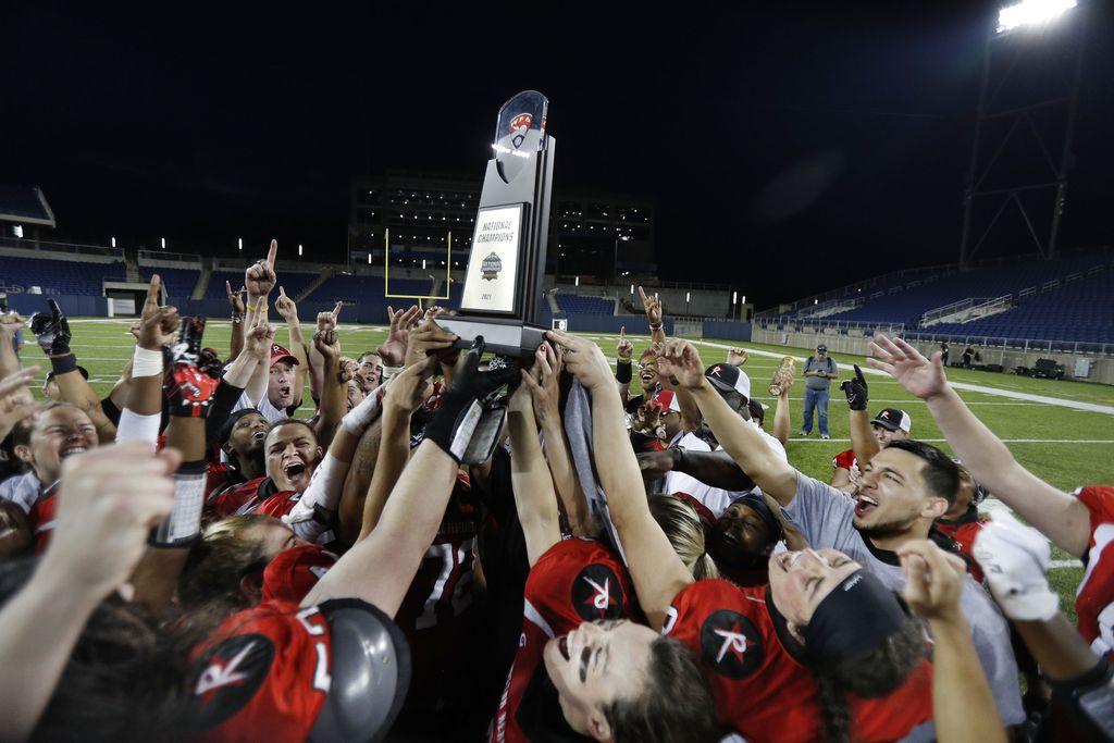Boston Renegades players raise the championship trophy