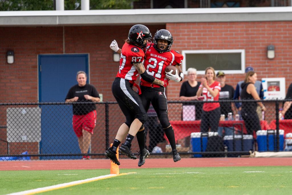 Boston Renegades players celebrate a touchdown