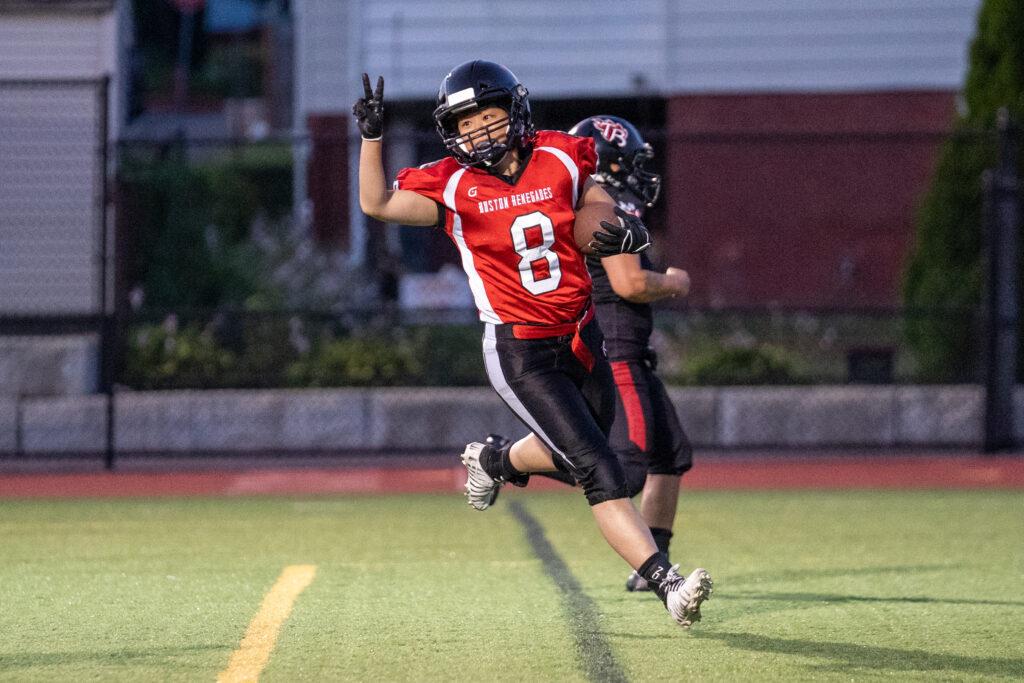 Lauren Yung celebrates asfter catching a touchdown pass