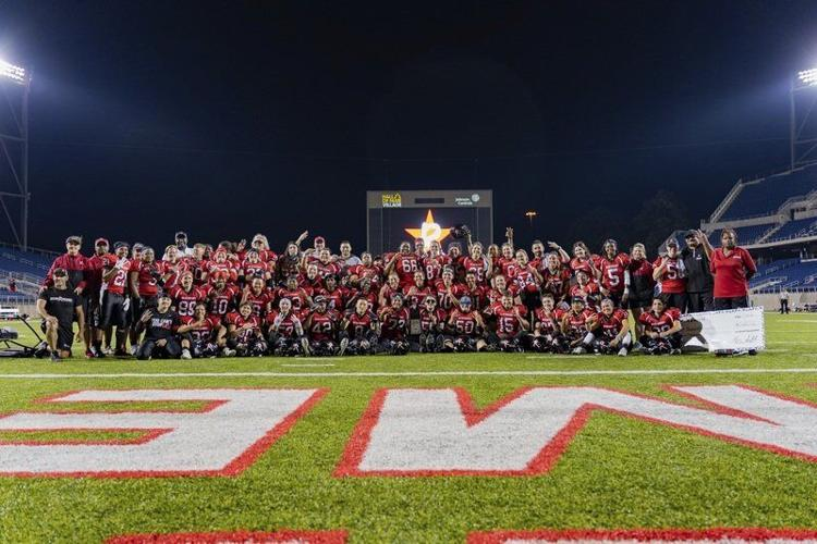 Boston Renegades women's football team photo after winning the championship.