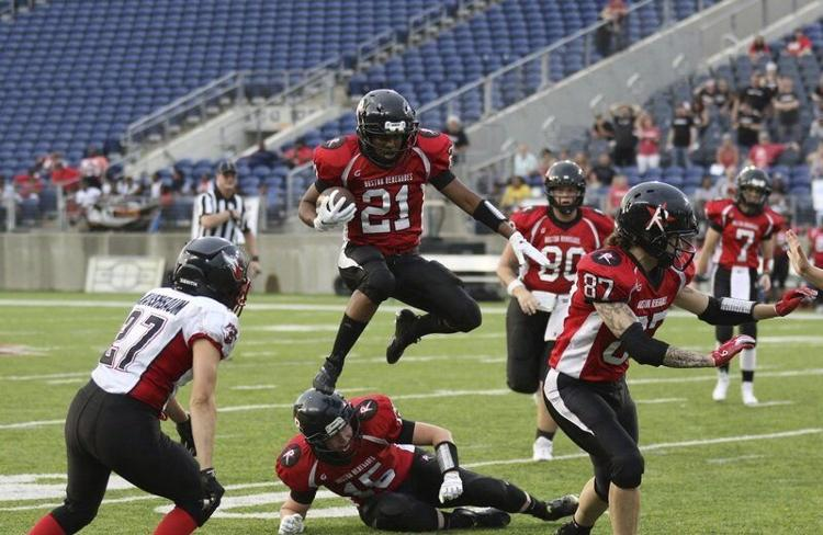 Chanté Bonds of the Boston Renegades leaps with the football.
