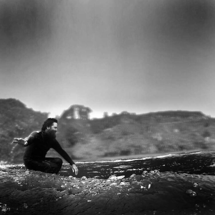 California artist Matt Beard gliding down the line while surfing
