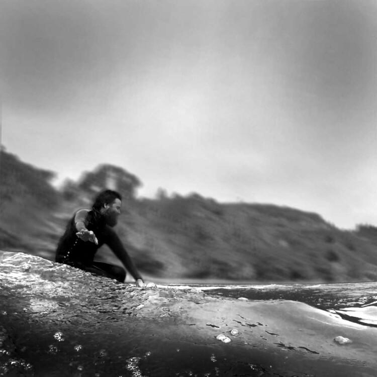 Artist Matt Beard enjoying the glide while surfing in California