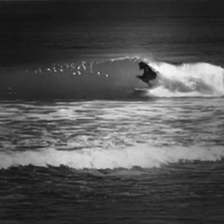 California artist Matt Beard tucking into a tight pocket while surfing in Central California