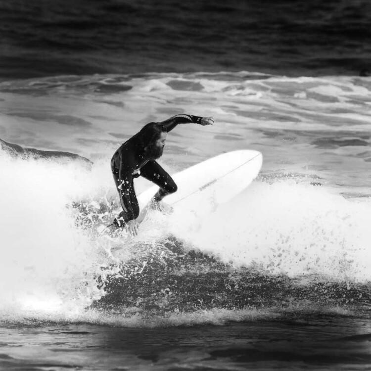California artist Matt Beard climbing the foam on a small wave in southern California