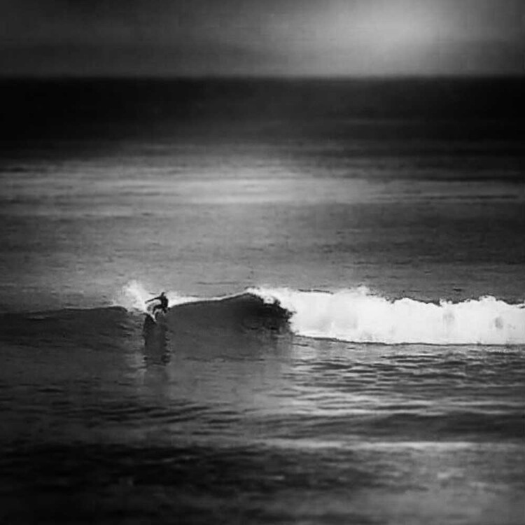 California artist Matt Beard carving off the shoulder of a reef wave in Central California