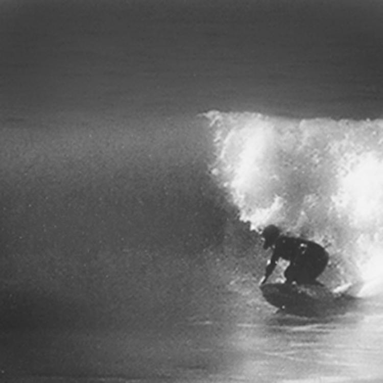 Artist Matt Beard leans off the bottom of a wave in Northern California