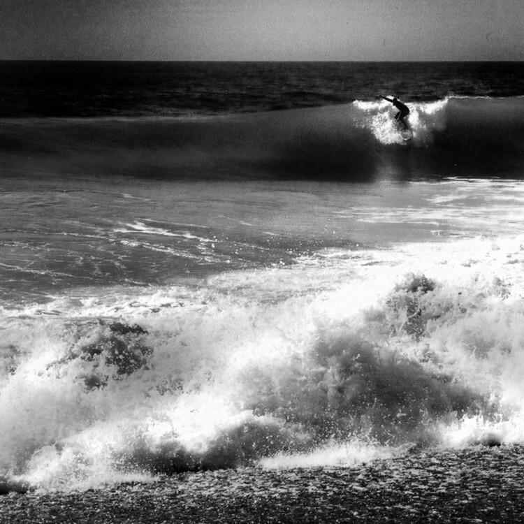 Artist Matt Beard surfs a fun beachbreak on the coast of Northern California