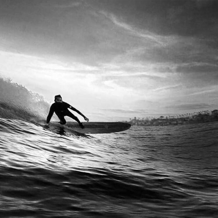 Artist Matt Beard glides into a wave in southern California