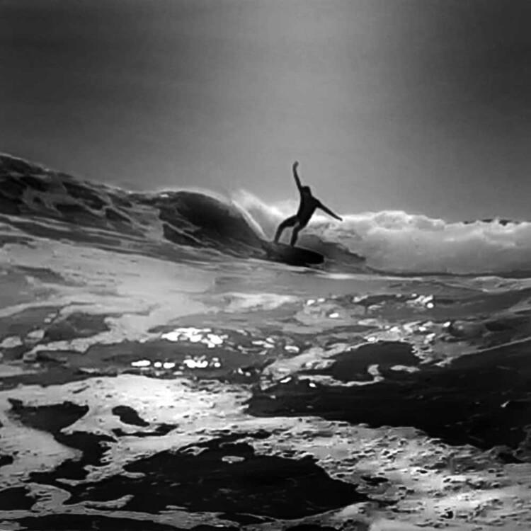 Artist Matt Beard surfing in Northern California