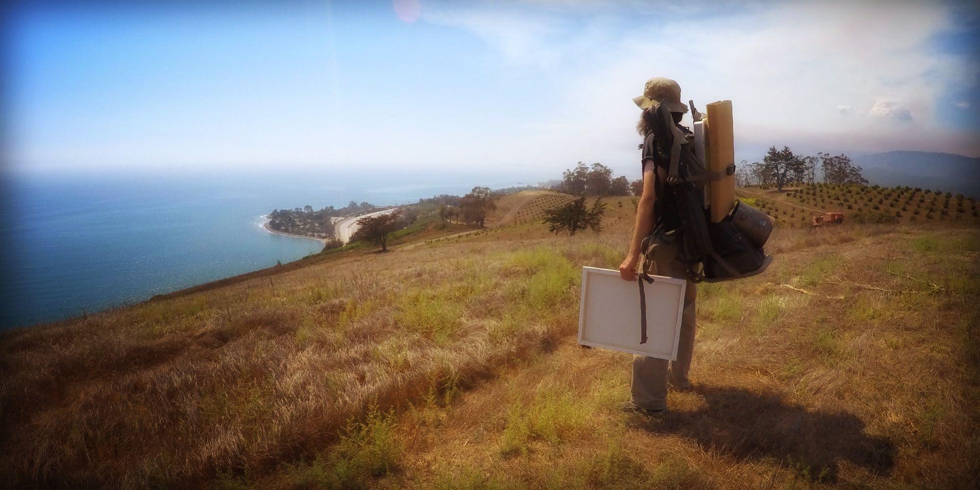 Artist Matt Beard getting ready to paint over Rincon on the California coast