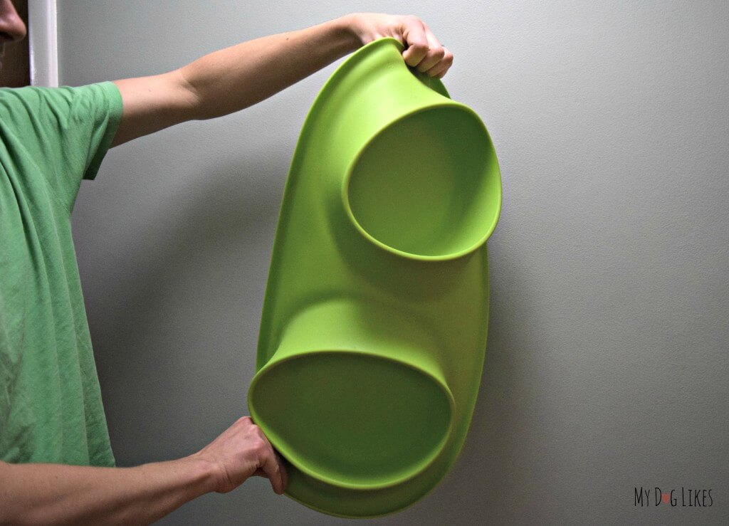 Demonstrating the flexibility of the Messy Mutts Feeder silicone base