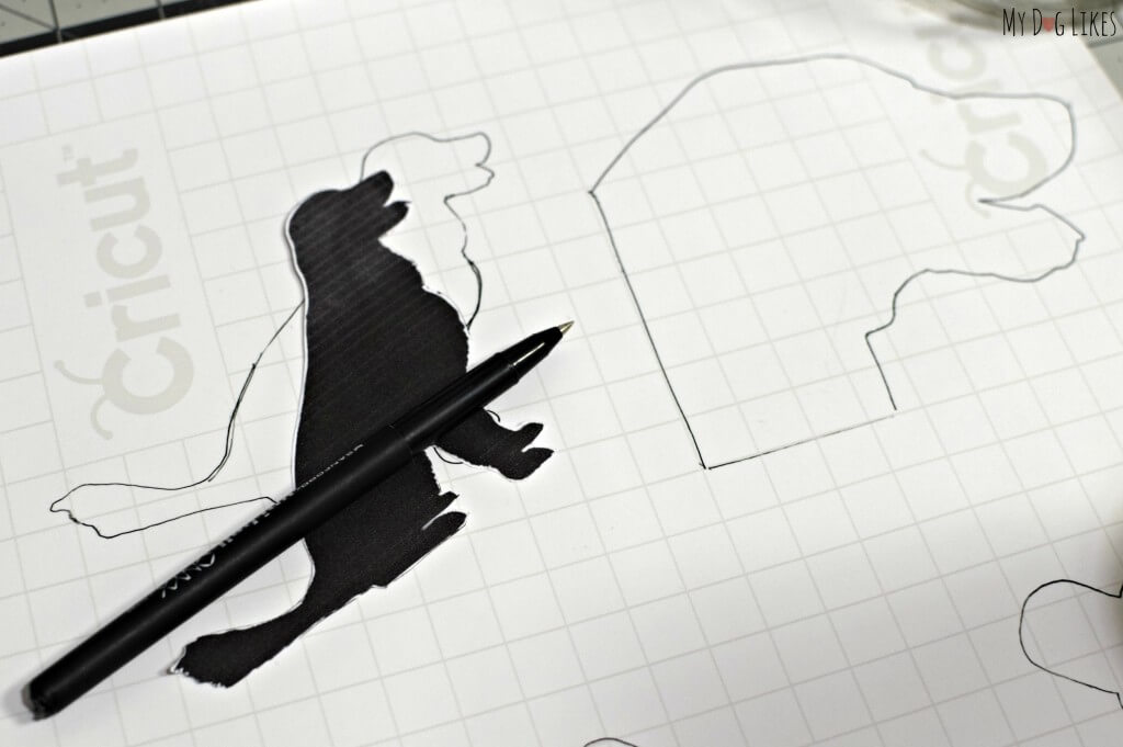 Tracing and cutting out dog silhouette patterns for our homemade treat jars.