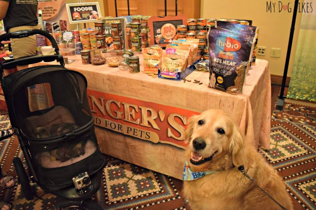 Harley trying to get some free samples from the reps at the Evanger's booth!